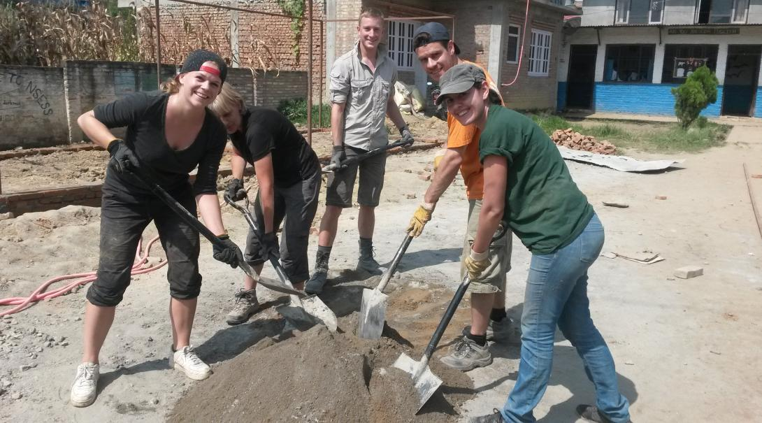 Projects Abroad Building volunteers lay foundation for a new classroom at a local school in Nepal